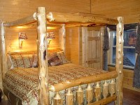 Rooms have king size bed with log frame